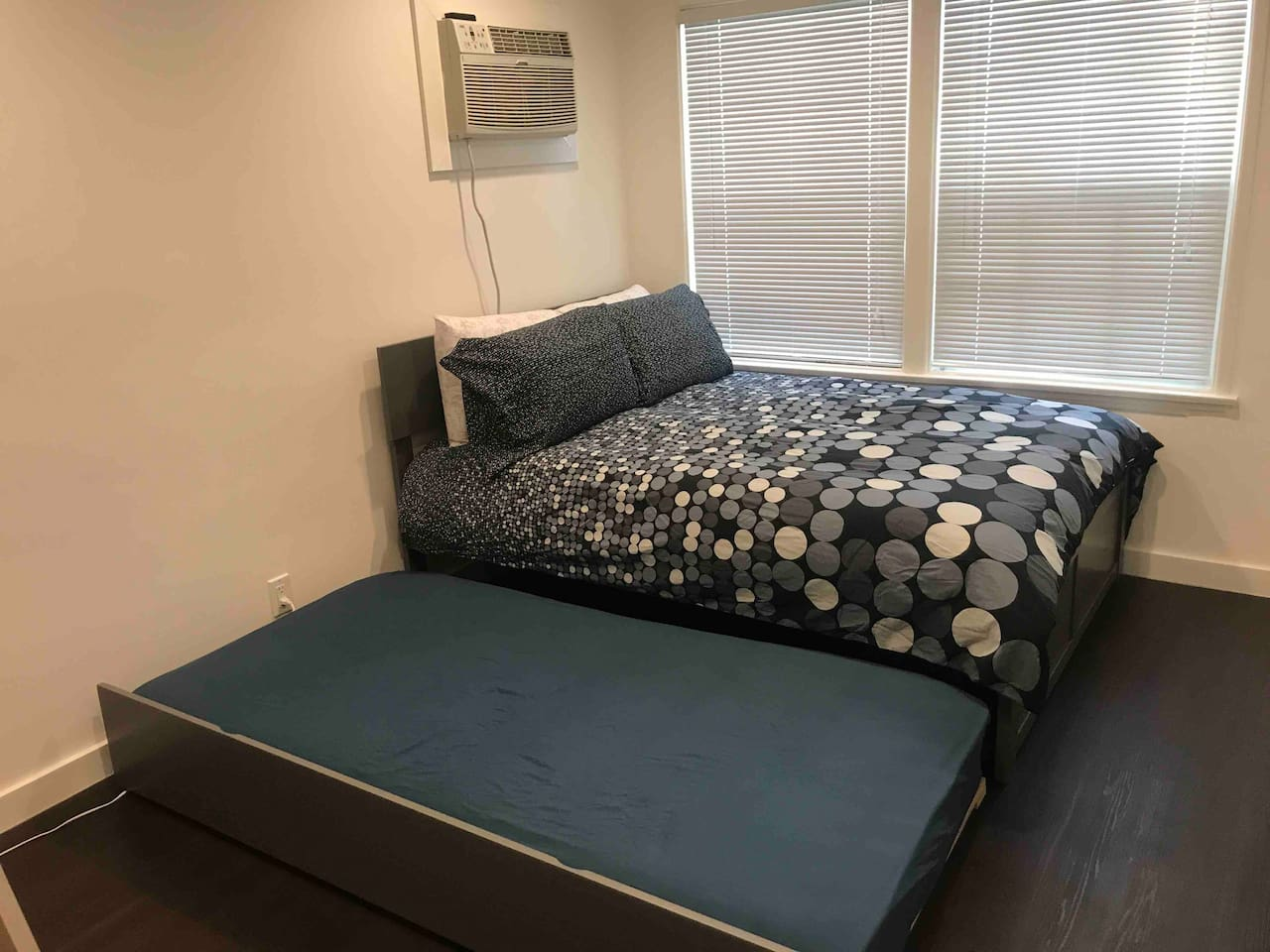 Trundle bed. The top bed is a full size bed and the one under it is a twin size.