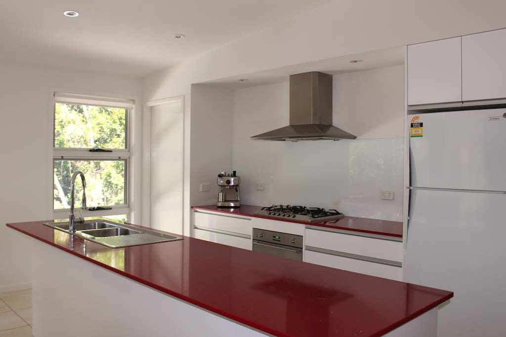 Kitchen with coffee machine, oven, gas cooktop, dishwasher, microwave and full size fridge/freezer