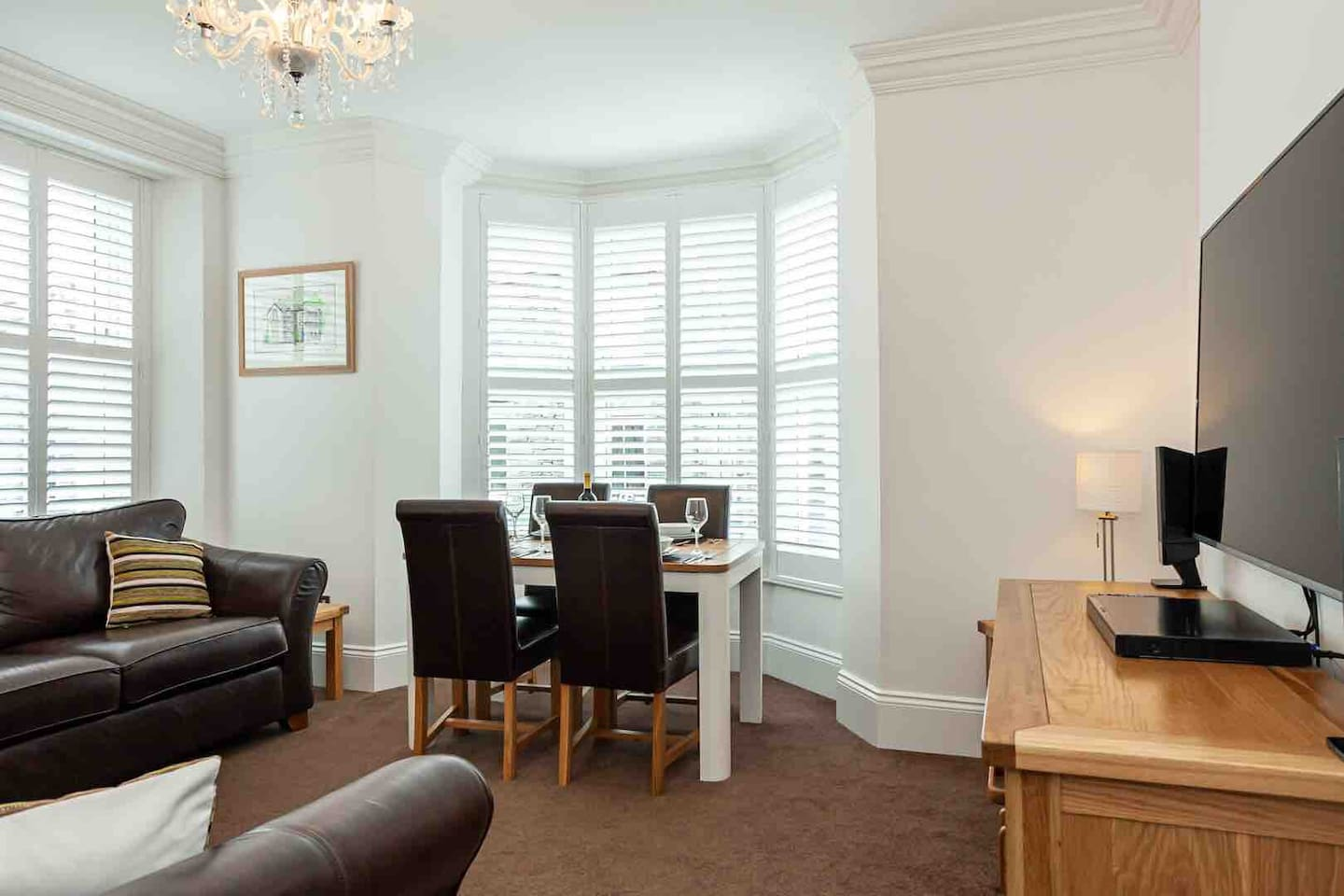 Living area with two large Couches, large Smart TV and family games complimented by incredible views of Skiddaw