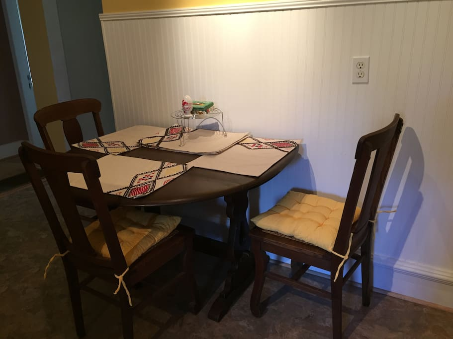 Table can be pulled out and extended for more seating.