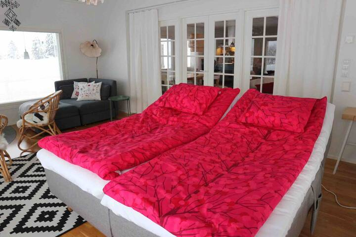 The third bedroom has engined beds, perfect to watch the scenery or fireplace. There are also sofa-bed for two in this room. Glass doors with the curtains gives as well privacy and light.