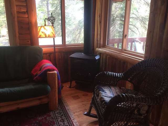 Cozy up by the gas fireplace while looking out at the beautiful lake view.  Cabin is less then 50 feet from the lake.