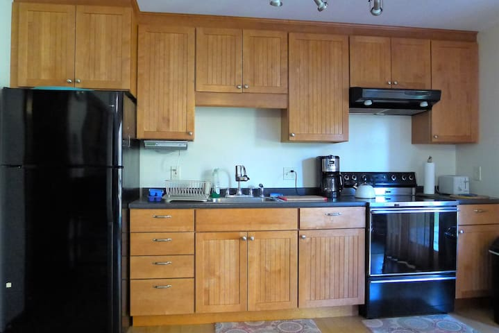 Fully equipped kitchen with full size range/oven and refrigerator.