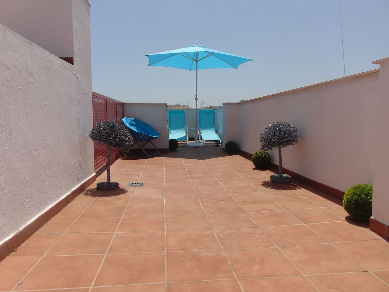 Relax and sunbathe on this  spacious rooftop terrace.