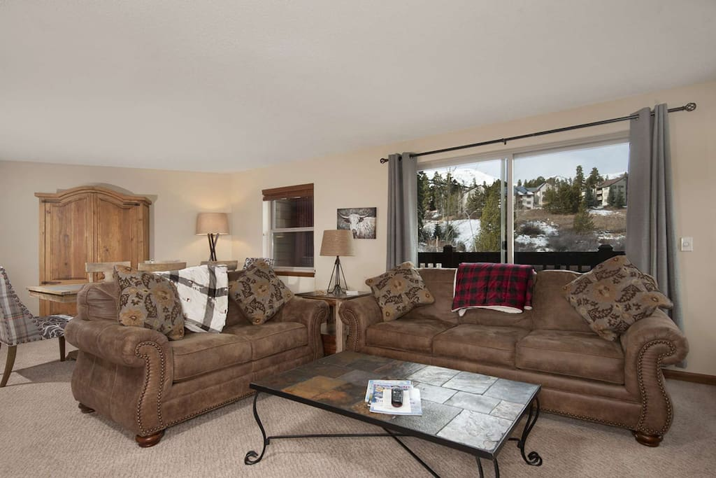 Comfy, all-new furniture and large open space behind unit is full of views and trails