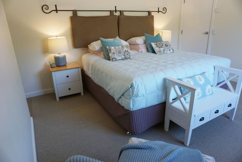 This bedroom also has its own fully tiled shower ensuite with heated towel rail and floor!
