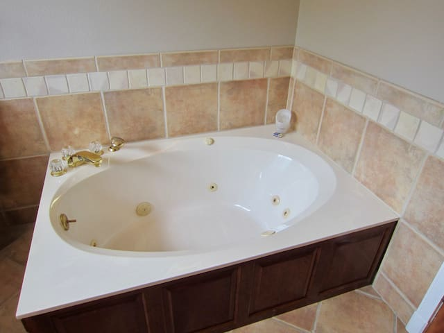 Large Jetted Soaking tub with Epsom Salts provided.