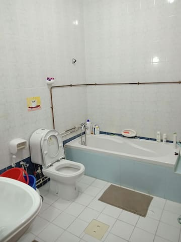 Clean and bright room with attached toilet