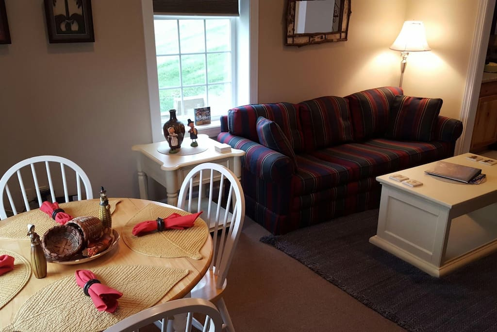Family room and dining for four.
