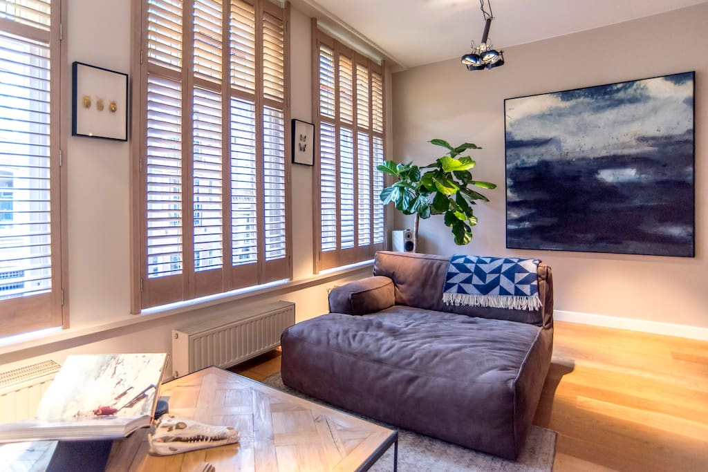 White wash oak shutters which can be closed at night or completed opened during the day.