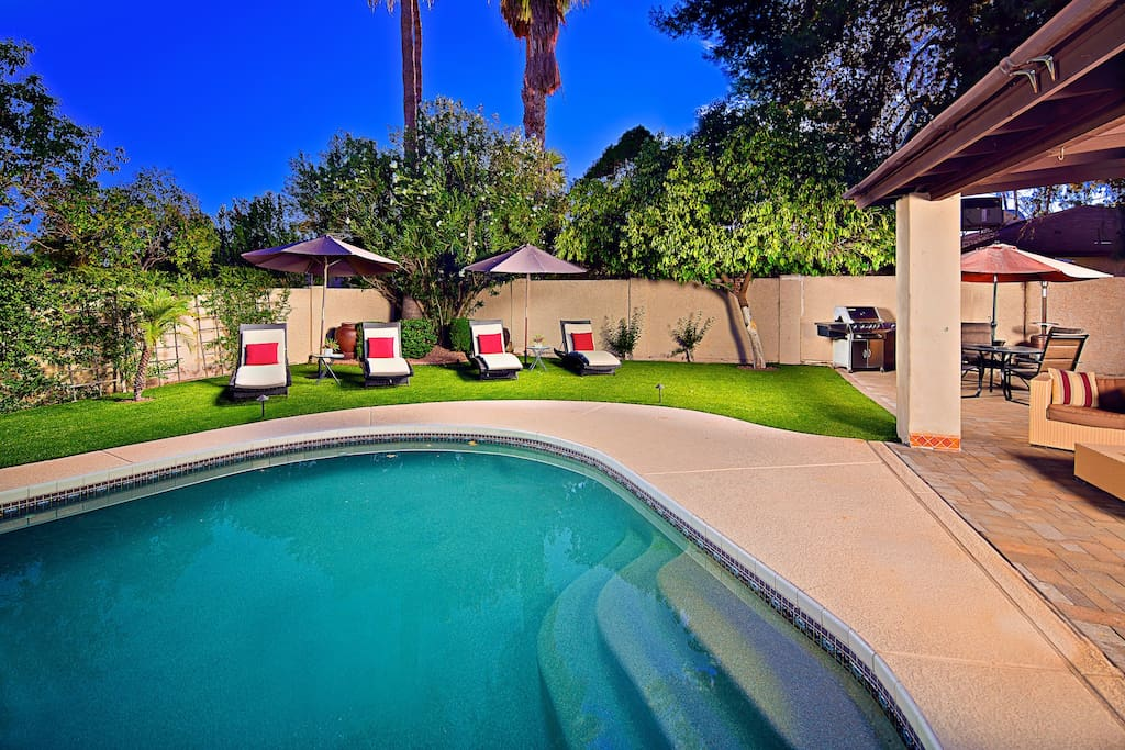 Relaxing heated pool with comfy lounge chairs.