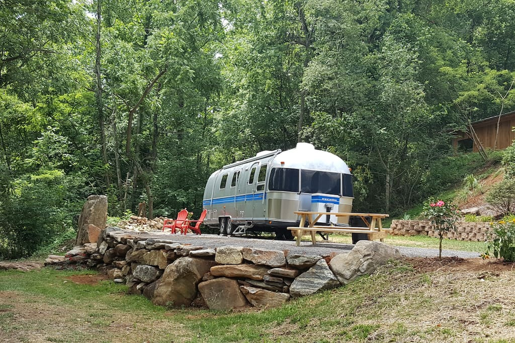 The Airstream Glamping site is nestled right along the river.
