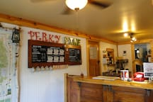 Check in at Pine Rest Cabins and grab a coffee at the Perky Pine Cafe to stay or to go.