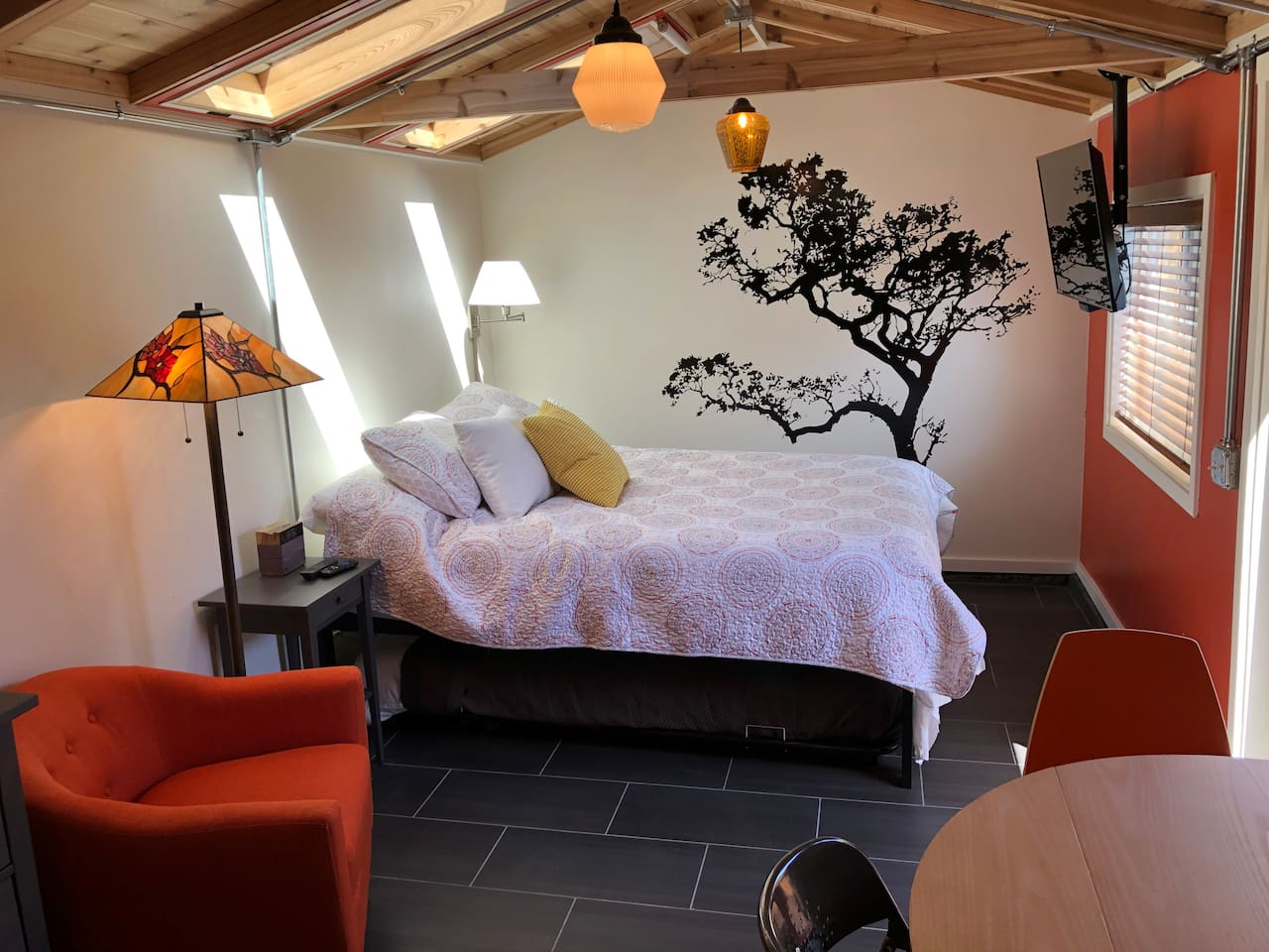 Skylights with shades, super comfy bed with mounted TV