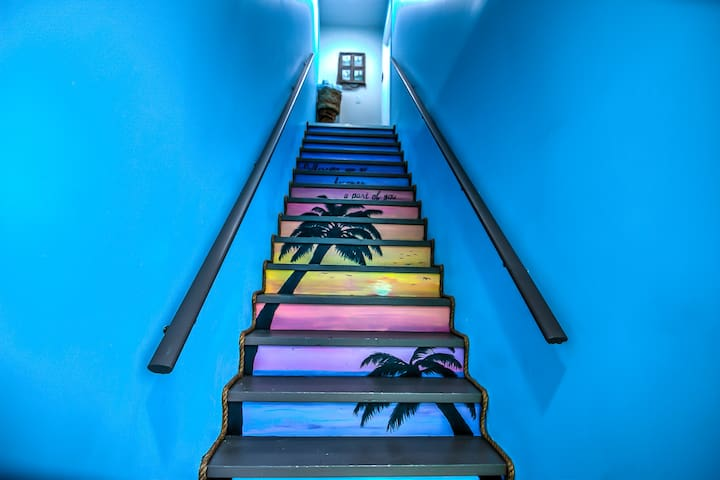 Custom painted stairwell by a local artist welcomes you to the Loft
