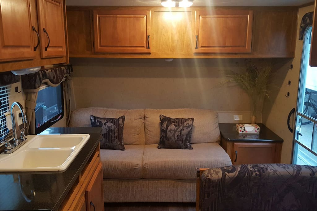 Couch sleeper, table for 4 (also a bed) and kitchen sink