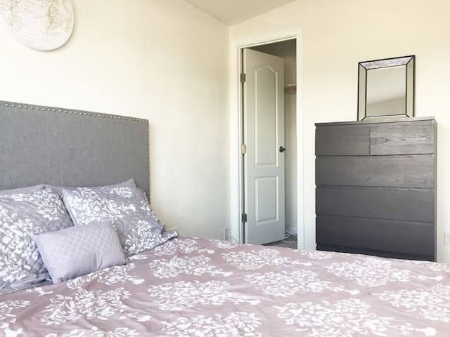 Your comfortable bed awaits. There is also a large dresser with a mirror, and an extra large walk-in closet