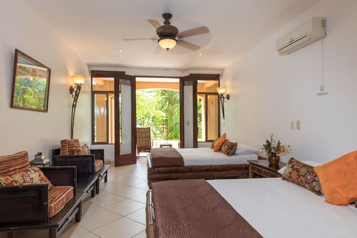 Suite # 5 with 2 Queen beds, jungle and garden views