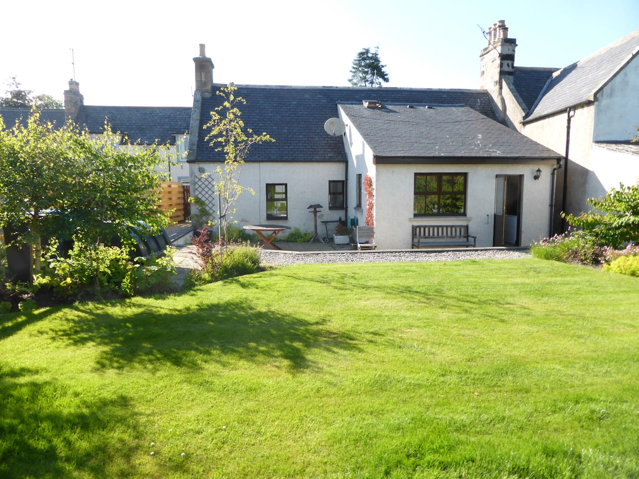 The cottage has a large, enclosed and sunny back garden with outdoor seating.