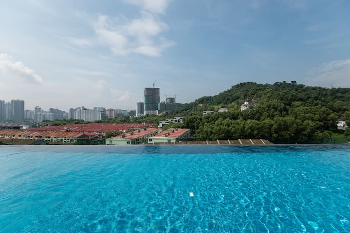 Rooftop  pool with hill view, breezy at  night :)