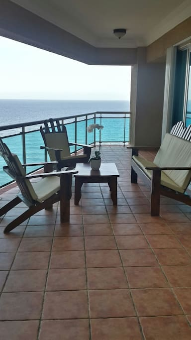 The large balcony with seating to enjoy the beautiful view just outside the living room.