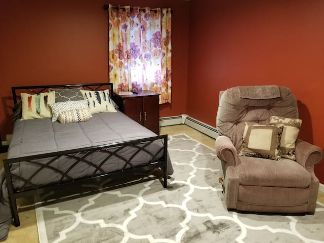 Full size bed can fit 2 people, Comfy recliner so you can put up your feet and watch TV.