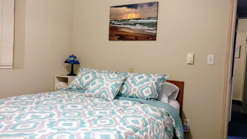 The West bedroom has a comfortable queen bed and a nice size closet with extra blankets if you get chilly. Photo shows our pattern bedspread.