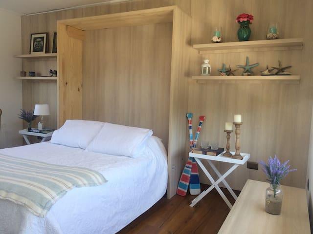 Cozy bedroom with the coastal decor