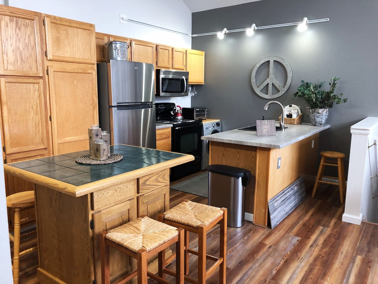 Great open FULLY stocked kitchen, including condiments, spices, coffee, tea  All new appliances, Euro W/D for small laundry needs Side Closet for sleeper sofa guest