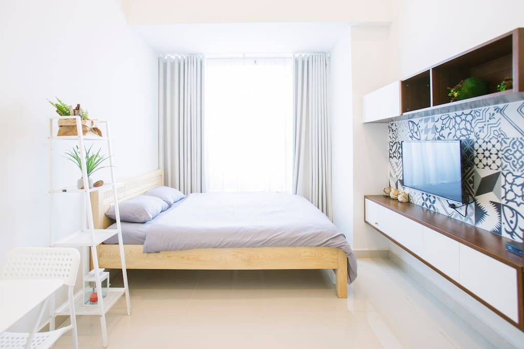 This is the main part of Mint's studio where you can relax in our Queen size bed and feel like home after hours of exploring HCM.