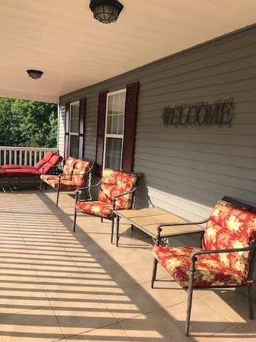 Porch welcomes you for a relaxing view of the scenic outdoors and a western sunset.
