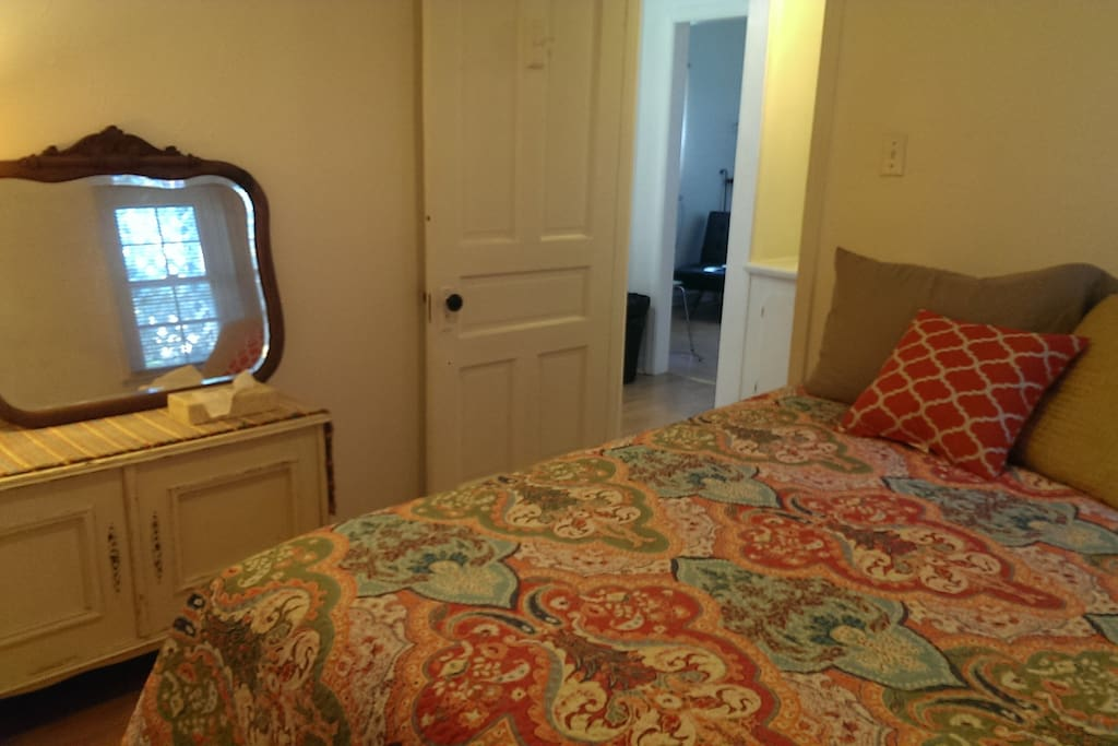 Comfortable and clean bedroom with a large closet for hanging full length items and storage of luggage.