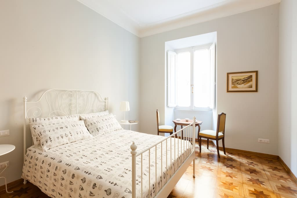 """Masterbedroom  being a 20 sq.mt with a queen bed  (63"""" x 80"""") and furnished with antiques which include an armoire."""