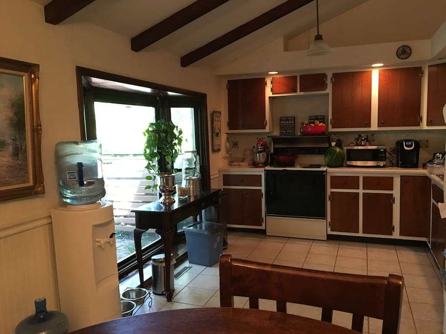 Full kitchen with Electric Range, dishwasher, and full fridge with all the necessities for cooking (We do a fair amount of cooking so we have pretty much anything you are looking for)