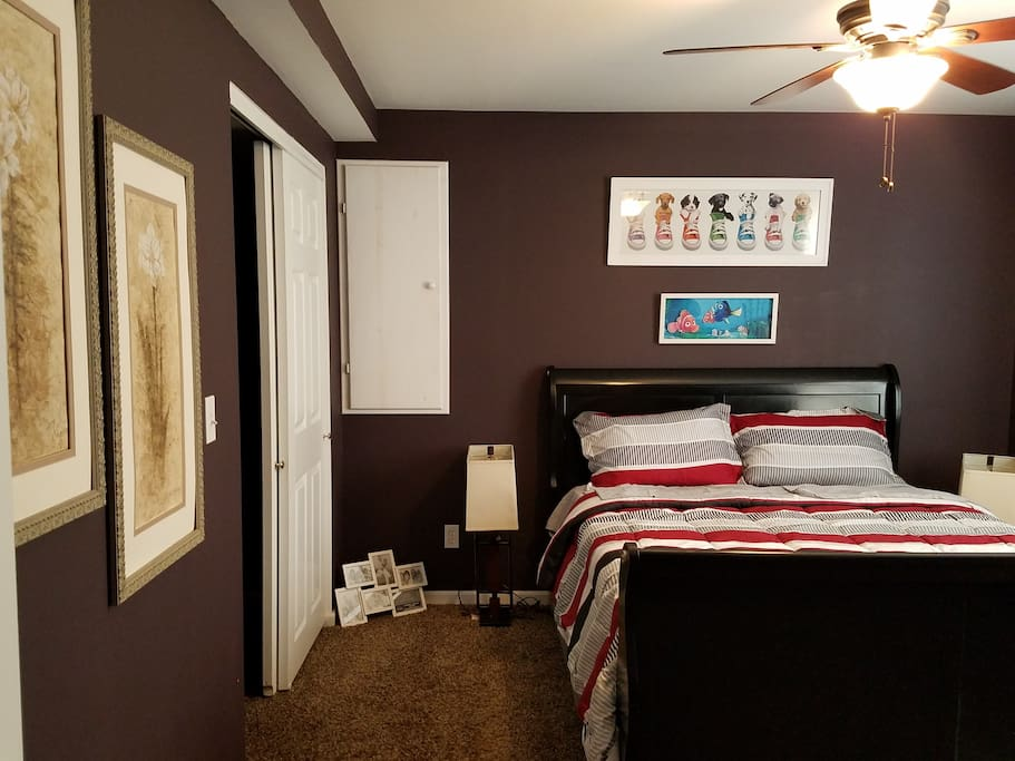 A very cozy bedroom with  huge walk in close, fan, A/C and bedside lamps.