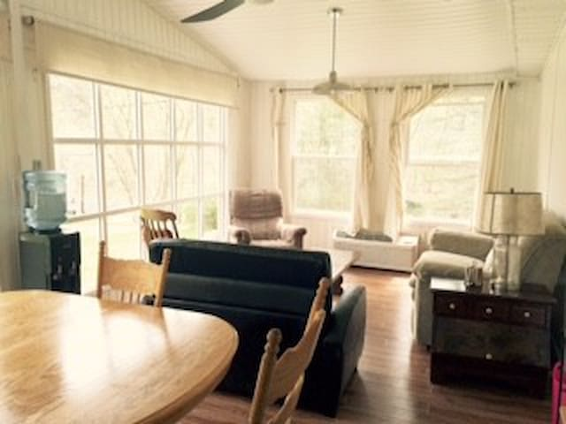 View of Sunroom:  24x12 room, table and chairs, conversation area, 1 single sofa bed