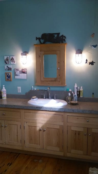 Full bath on second floor includes hand made (by Paul) cabinetry and poured concrete counter tops.