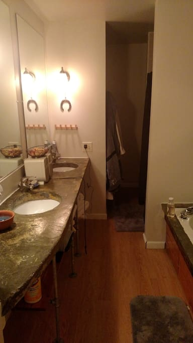 We have a huge bathroom with double sinks, an a separate shower and soaking tub.