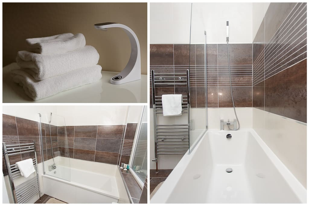 Immaculate bathroom with towels provided