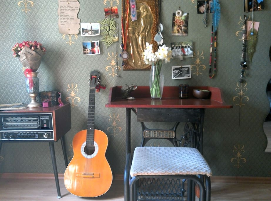 Room #1 Wonderland. An old radio and vintage desk made of an old sewing machine.