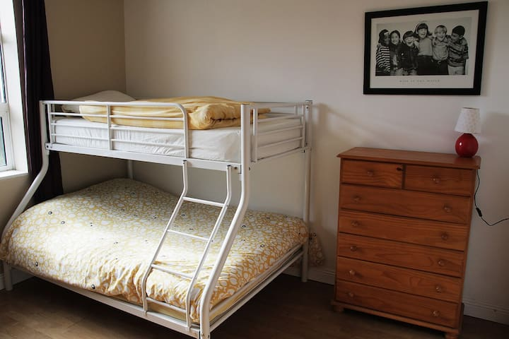 Triple bunk bed includes a double bed and one single on top