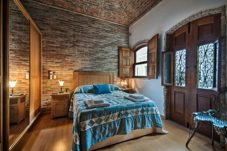 The master bedroom offers a large king size bed