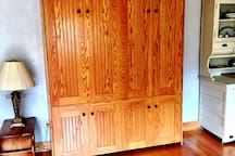Murphy bed that folds out into the living room.