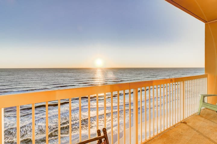 Cool & comfortable beachfront condo w/ a private balcony, shared pool, & gym