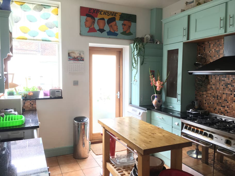 Kitchen with cooker, washing m/c, fridge-freezer, dishwasher & microwave