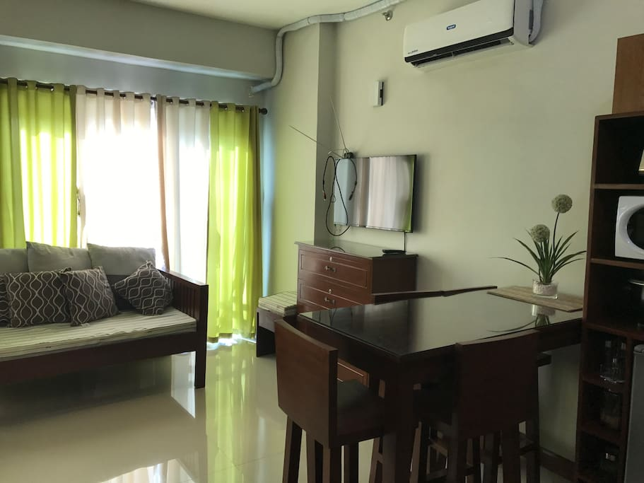 A studio type condominium with the following offered amenities: swimming pool, a gym, a tennis court and a recreation center (a private karaoke room and billiard table). What you see is what you get......