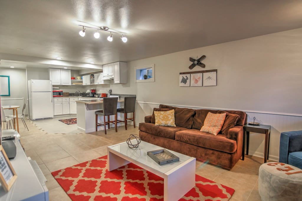 Open concept living space offers living room and large eat-in kitchen with bar.