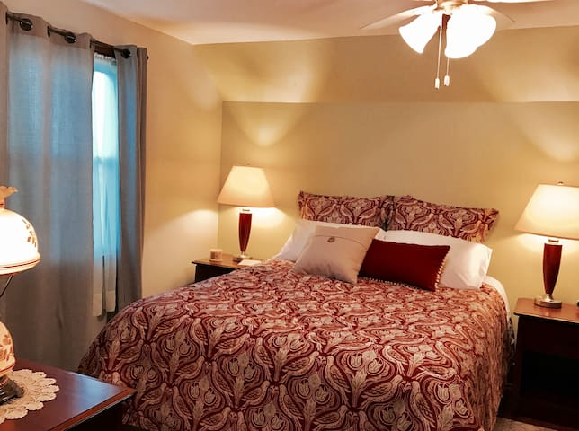 Upper north bedroom with queen bed and sitting alcove