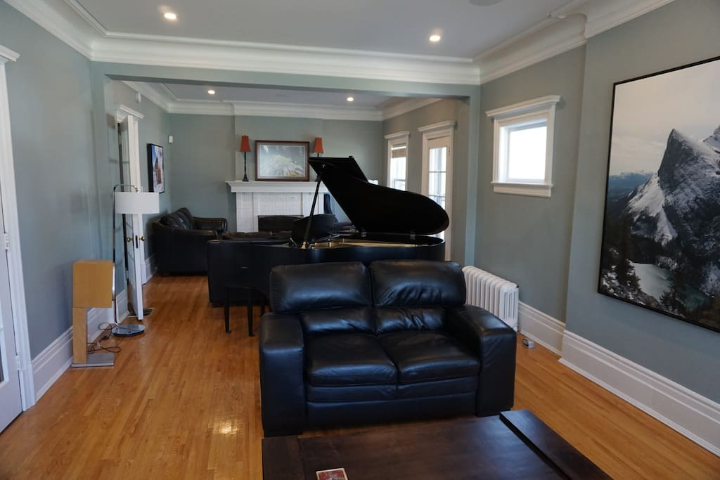 Living room with two large sitting areas complete with grand piano!
