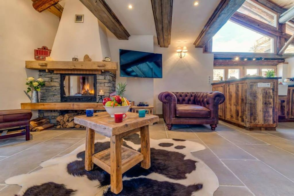 Wall mounted TV and a modern wood burning fire